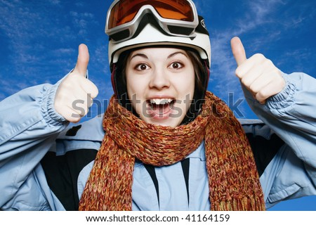 Portrait of the cheerful girl in a mountain-skiing suit.