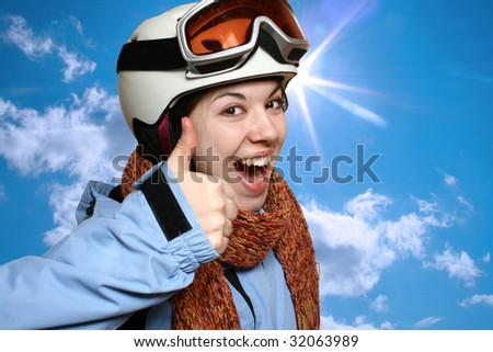 Portrait of the cheerful skier on a background of the blue sky.