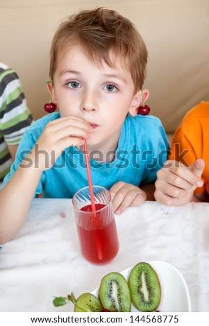 portrait of the child drinking juice