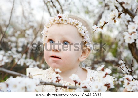 portrait of the child in flowers - stock photo