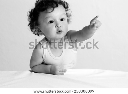 Portrait of the child on alight background. - stock photo