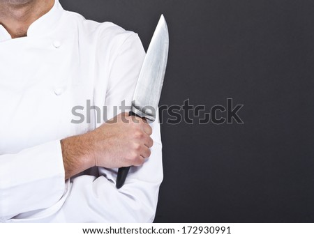 portrait of the cook over dark background - stock photo