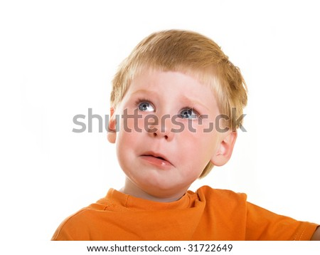 Portrait of the crying boy on a white background - stock photo