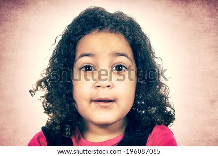 Portrait of the curious child with curly hairstyle