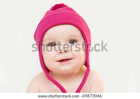 Portrait of the cute baby with red cap - stock photo