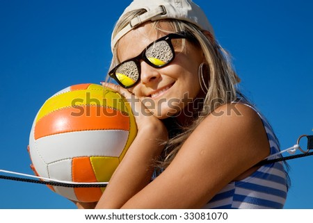 Portrait of the cute girl in mirror glasses with a ball - stock photo