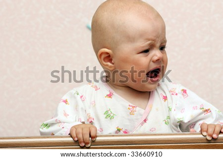 Portrait of the delightful baby - stock photo
