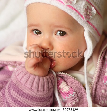 Portrait of the delightful baby close up, soft focus - stock photo