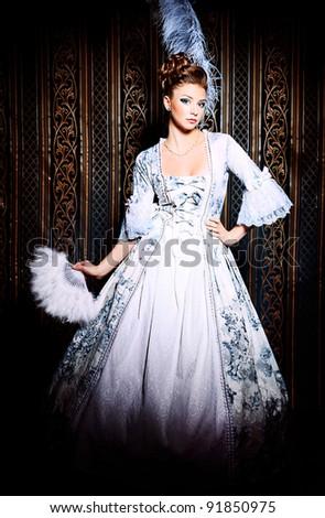 Portrait of the elegant woman in medieval era dress. - stock photo