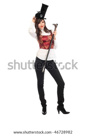 Portrait of the elegant young woman in 19th century costume holding walkingstick in her hands. Shot in a studio. - stock photo