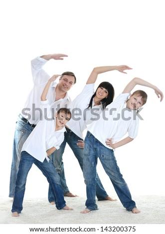 Portrait of the European family of four doing exercises - stock photo