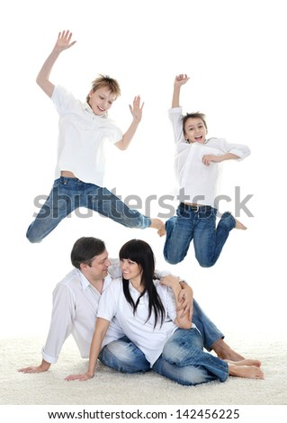 Portrait of the European family of four on a light background
