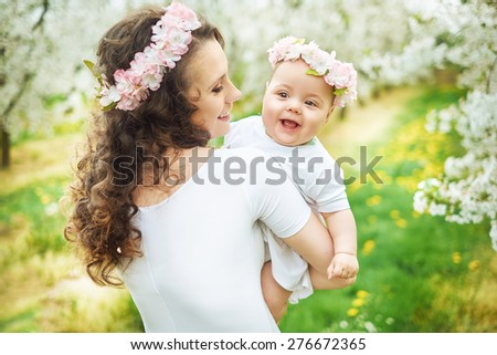 Portrait of the family in the blooming orchard - stock photo