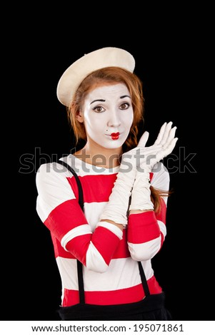 Portrait of the female MIM comedian , isolated on black  background.Studio shot. - stock photo