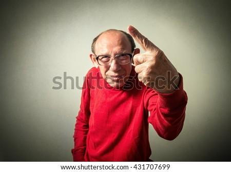 portrait of the funny senior man - stock photo