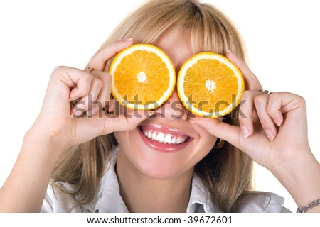 Portrait of the funny smiling girl with oranges. Isolated