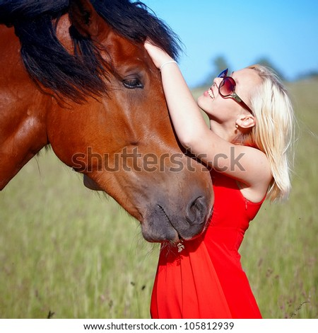 Portrait of the girl embracing a horse - stock photo