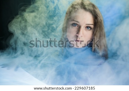 Portrait of the girl in a smoke - stock photo