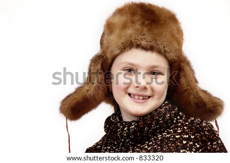 Portrait of the girl in a winter cap on a white background. - stock photo