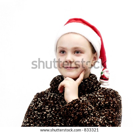 Portrait of the girl in cap Santa Claus on a white background. - stock photo