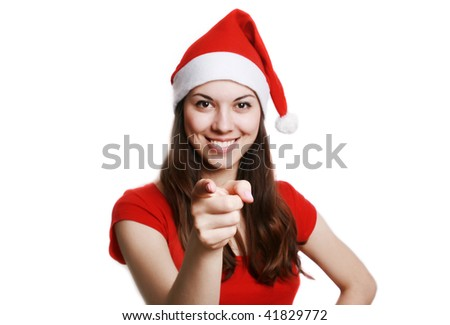 Portrait of the girl in the christmas suit, showing a finger.