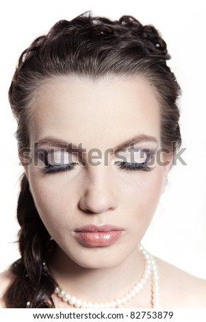 Portrait of the girl of the bride, with a make-up and a hairdress - stock photo