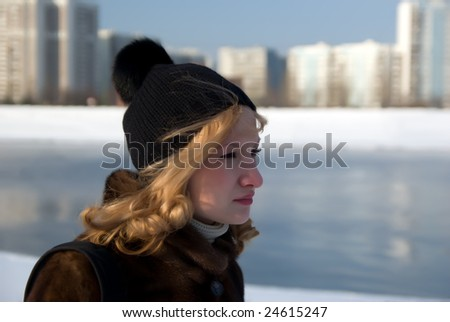 Portrait of the girl of the river walking on coast in the winter