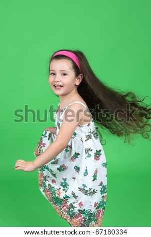 Portrait of the girl on a green background - stock photo
