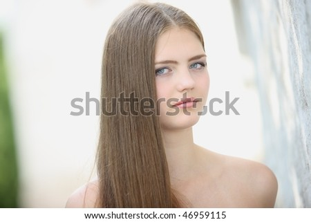Portrait of the girl on a light background
