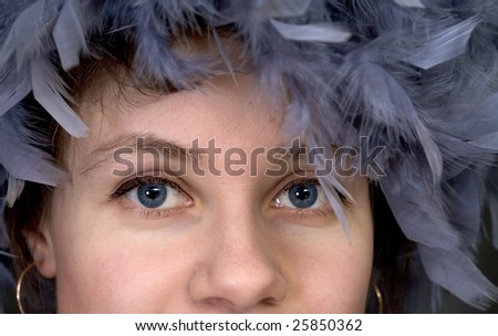 Portrait of the girl with a boa on a head closeup