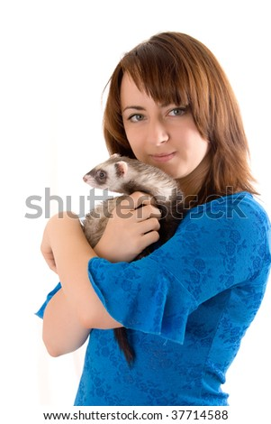 Portrait of the girl with a domestic polecat on hands