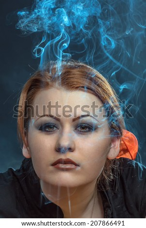 Portrait of the girl with a smoke