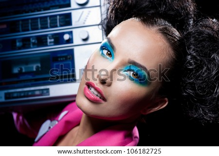 Portrait of the girl with a tape recorder - stock photo