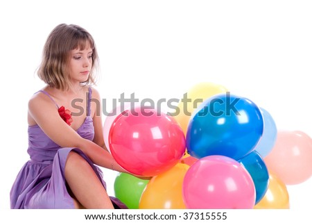portrait of the girl with colorful balloons on white background