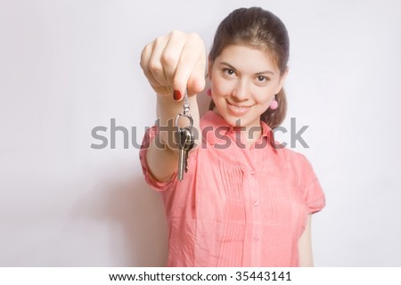 Portrait of the girl with keys in hands. - stock photo