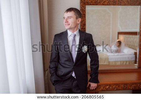 Portrait of the groom in the room
