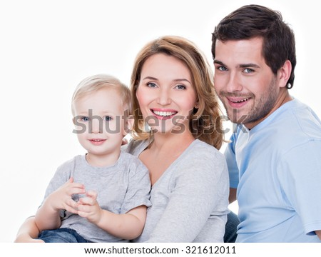 Portrait of the happy family with little child looking at camera - isolated on white background - stock photo