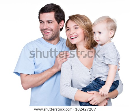 Portrait of the happy family with little child looking sideways - isolated on white background. - stock photo