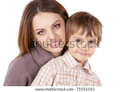 Portrait of the happy mother and son of six years isolated on white