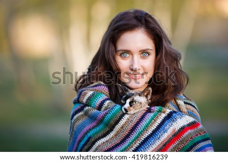 Portrait of the happy smiling girl with sphynx - stock photo