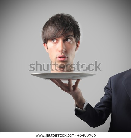 Portrait of the head of a businessman standing on a dish carried by a man's hand - stock photo