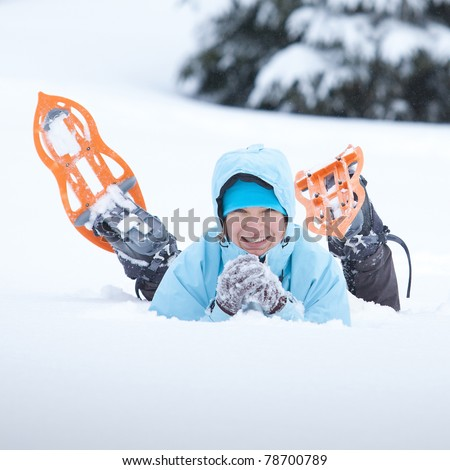 Portrait of the hiker lying in snow - stock photo