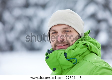 Portrait of the hiker that stands in snow - stock photo