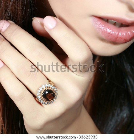 Portrait of the lady with the big ring with a jewel on a finger - stock photo
