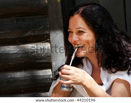 Portrait of the Latin American woman drinking a mate