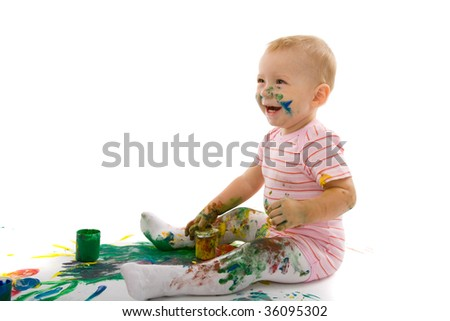 portrait of the little boy covered with bright paint