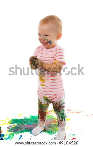 portrait of the little boy covered with bright paint - stock photo