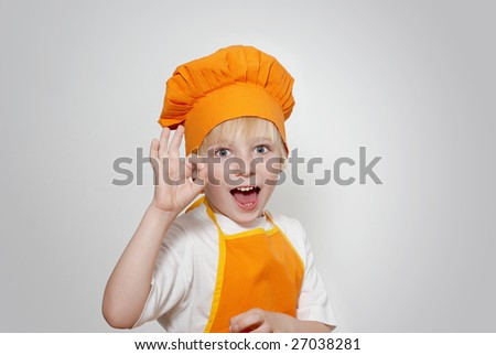 Portrait of the little cook - stock photo