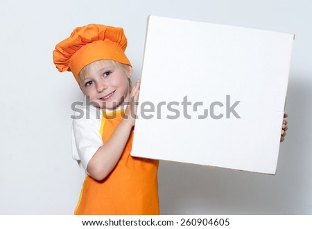 Portrait of the little cook with a box for pizza - stock photo