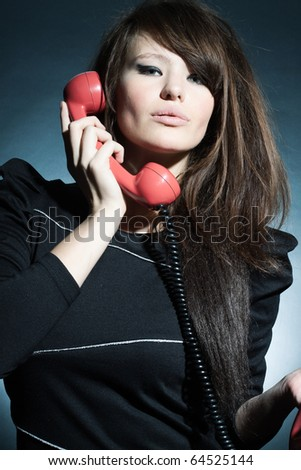 Portrait of the magnificent business woman speaking on a retro to phone. - stock photo